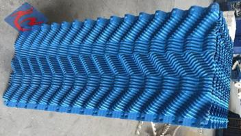 What is fill film system of cooling tower fill?